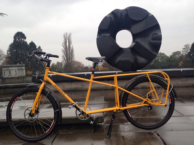 A cargo bike positioned to look like it is carrying a sculpture